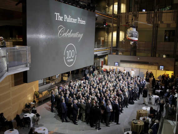 The largest-ever gathering of Pulitzer Prize recipients pose for a photograph during a celebration honoring the centennial of the Pulitzer Prize at the Newseum in Washington